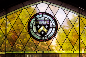 Kenyon seal in stained glass at Ransom Hall